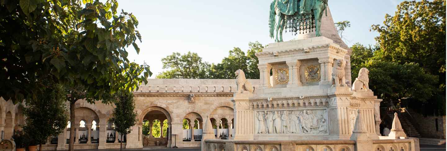 The famous fisherman's bastion at sunrise with statue of king stephen i and parliament of hungary