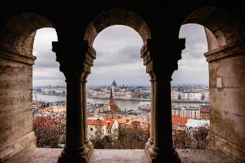 Views of the hungarian parliament through the walls of the budapest castle