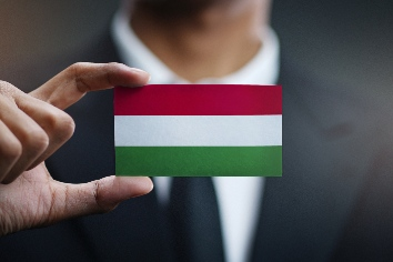 Businessman holding card of hungary flag