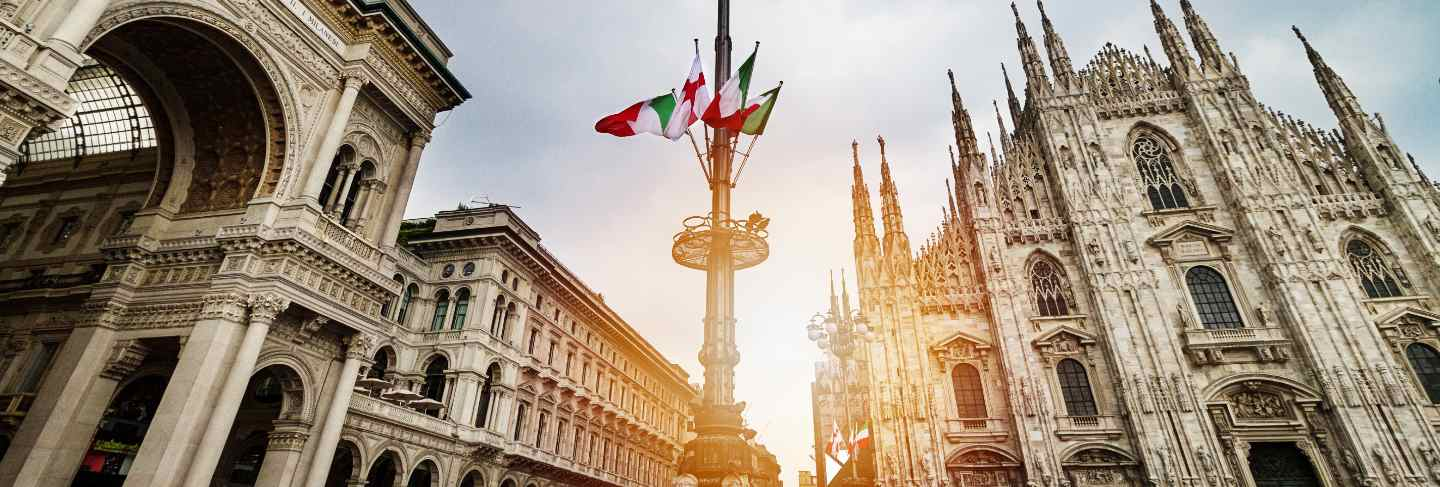 Beautiful panoramic view of duomo square in milan with big street