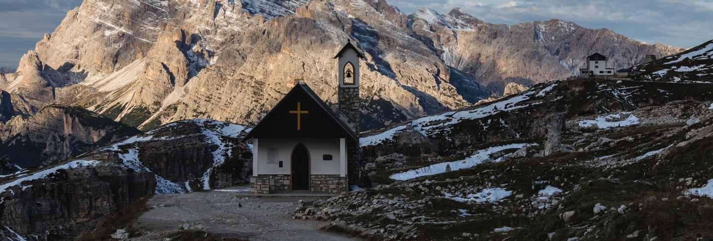 Beautiful small church in the snowy italian alps in winter