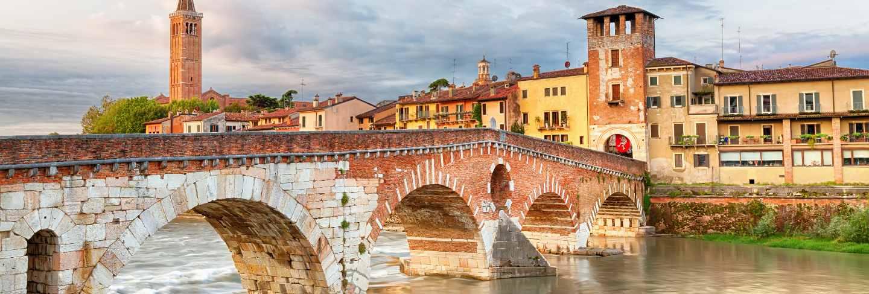 Famous verona landmark. ponte di pietra over adige river during sunrise.