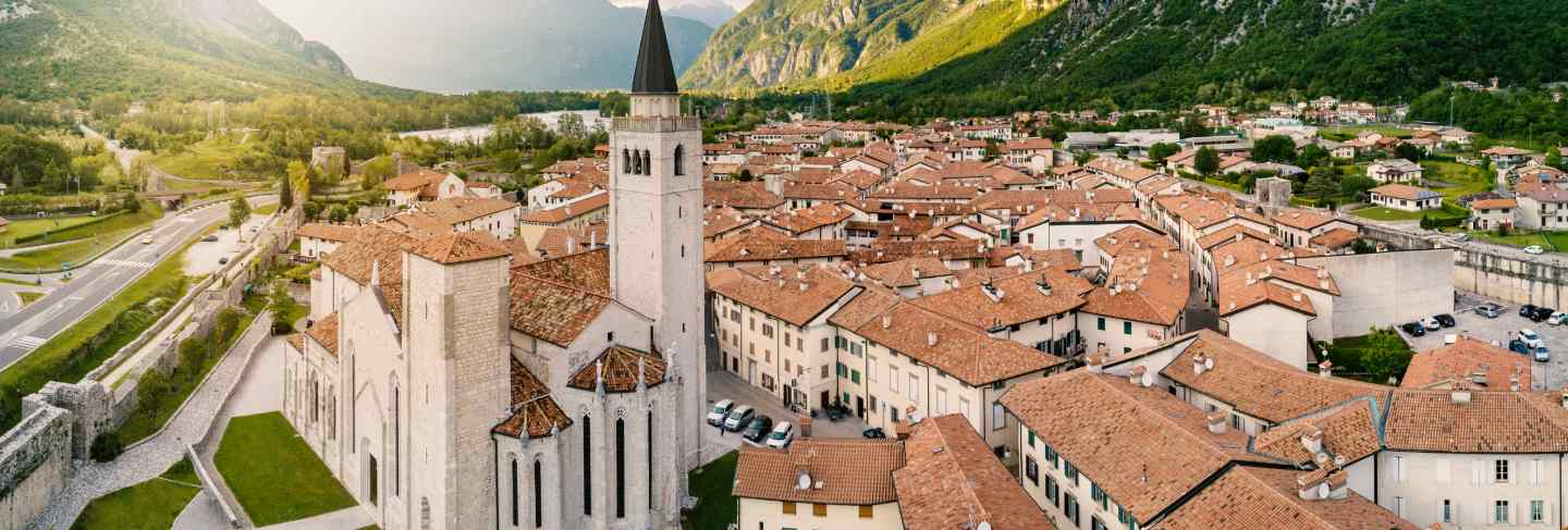 Aerial panoramic view of s. andrea apostolo cathedral of venzone, northern italy.
