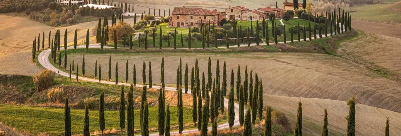 Common italian countryside. farm house and amazing fields near val d'orcia. tuscany. siena. italy. europe