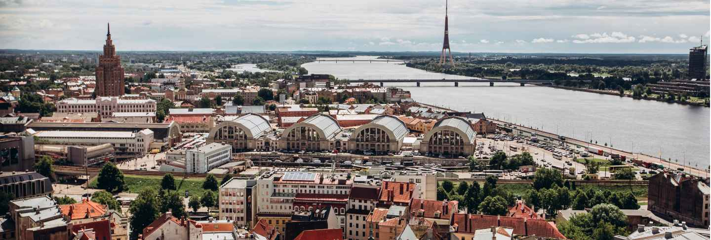 Red roofs of old riga. riga cityscape on a sunny summer day. city aerial view of the old town with the dome cathedral and the daugava river in the city of riga