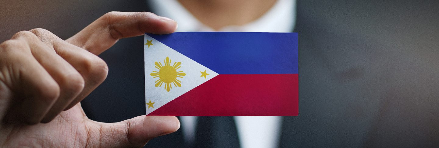 Businessman holding card philippines flag