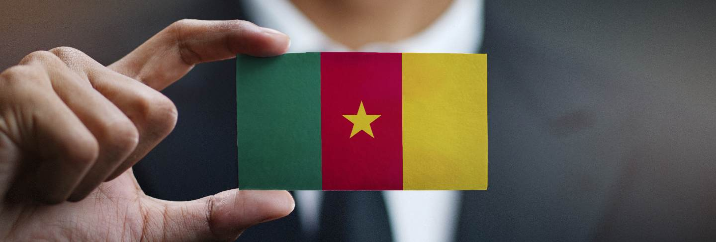 Businessman holding card of cameroon flag