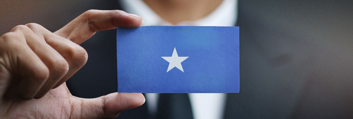 Businessman holding card of somalia flag