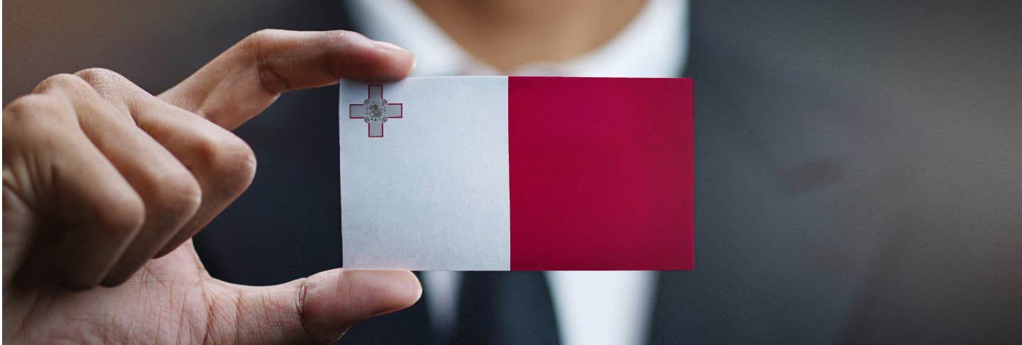 Businessman holding card of malta flag Premium Photo