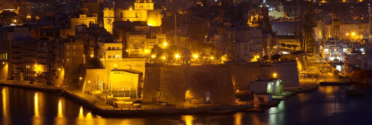 Night view of senglea from valetta Free Photo