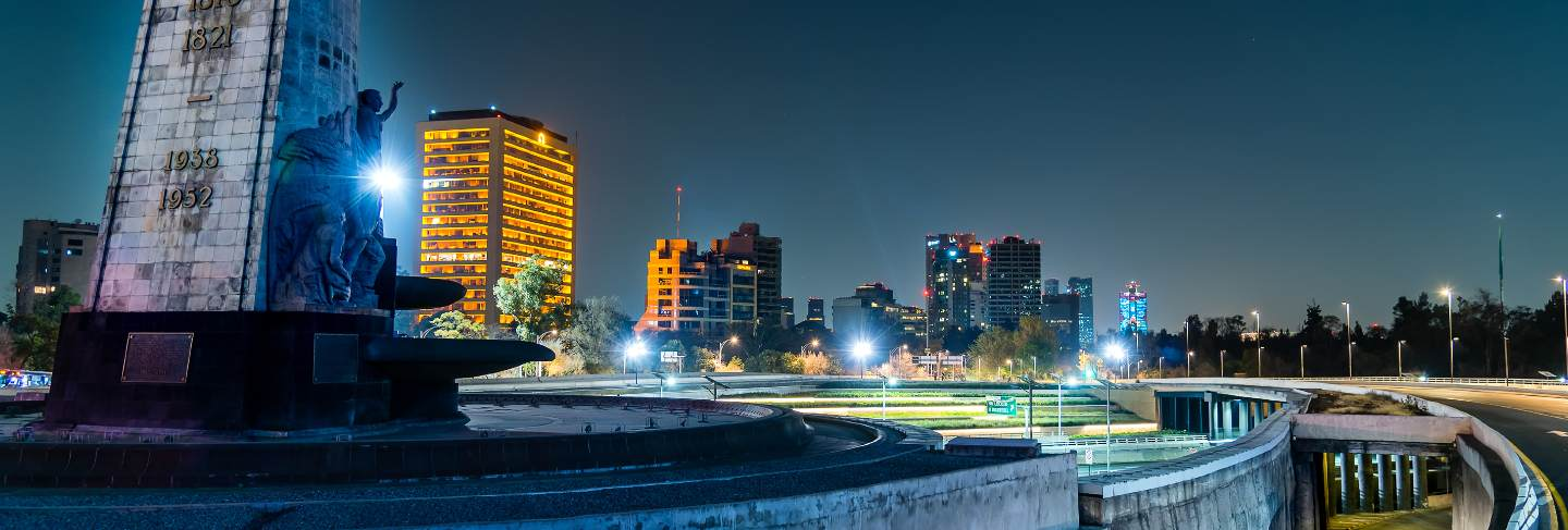 Mexico city night landscape, petroleum fountain and periferico highway