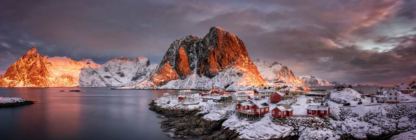 Village with snow and mountains in the arctic, lofoten islands in norway, scandinavia