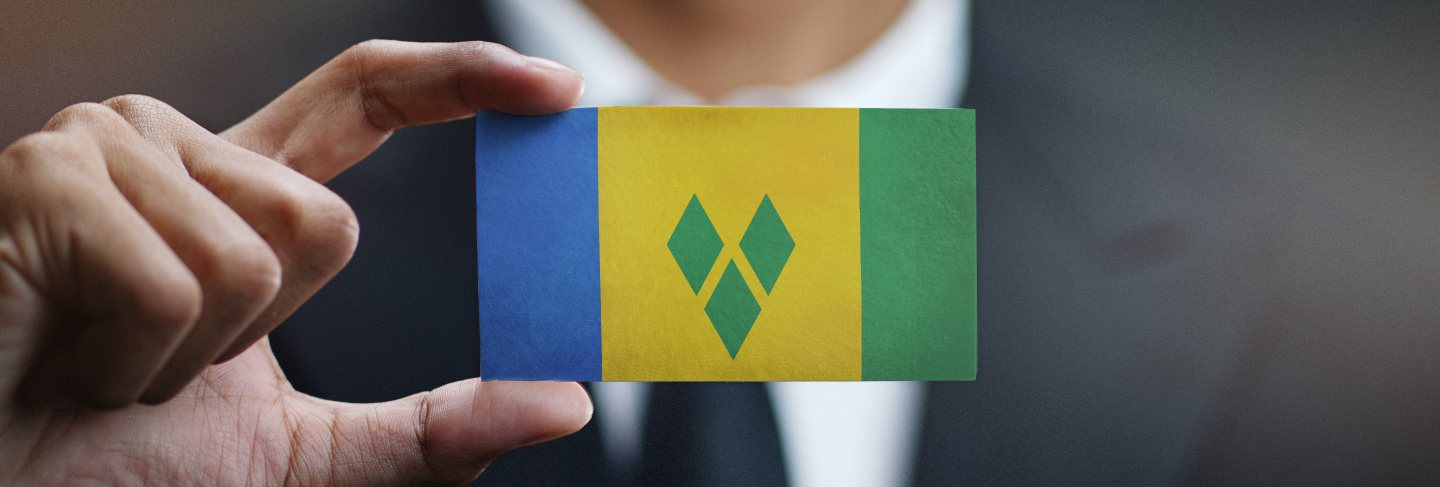 Businessman holding card of saint vincent and the grenadines flag