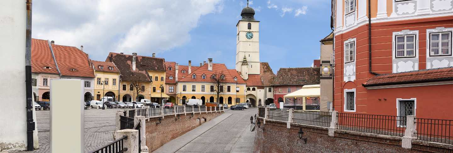 Sibiu city downtown with houses a bridge and a tower with clock, romania