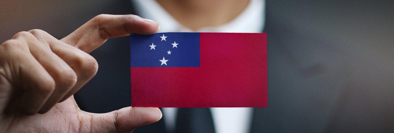 Businessman holding card of samoa flag