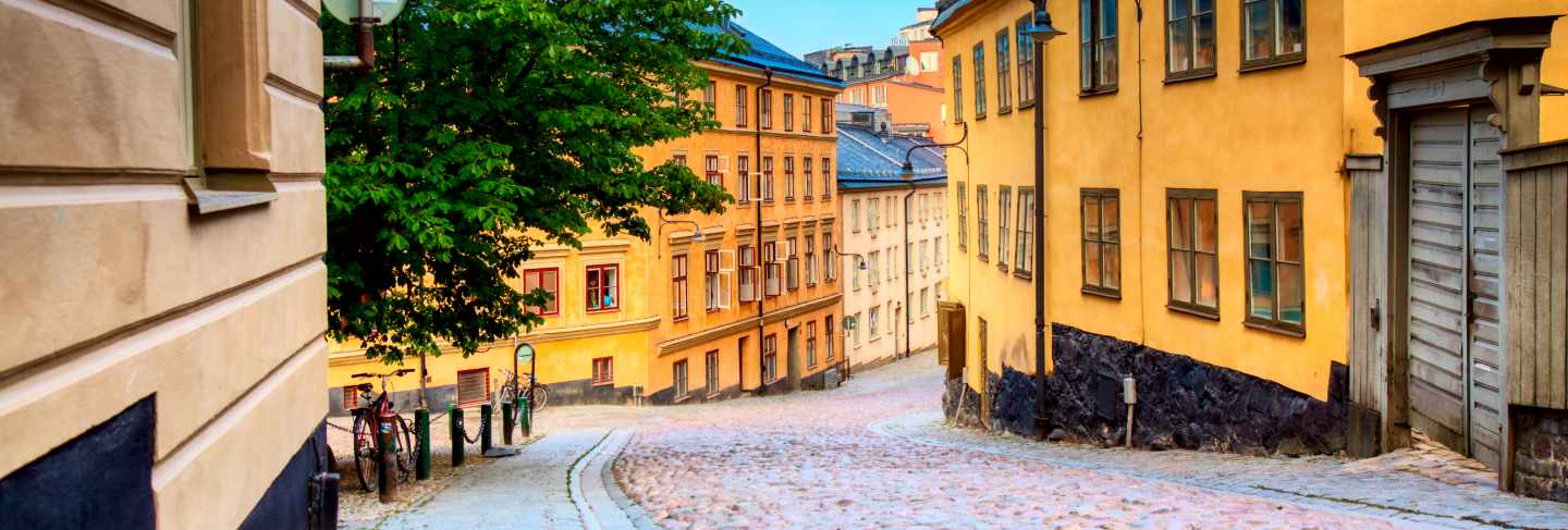 The narrow cobblestone street bastugatan in sodermalm with medieval houses in stockholm at summer sunny day.