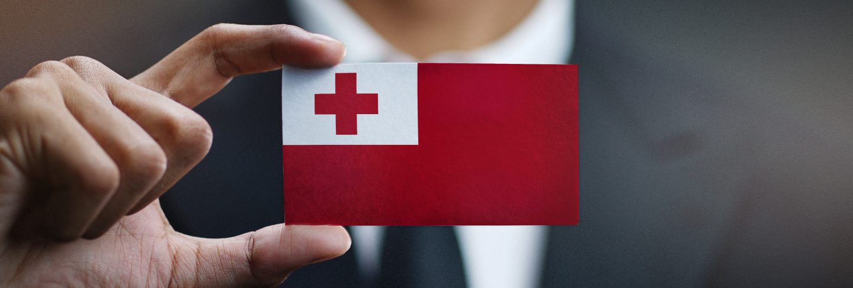 Businessman holding card of Tonga flag