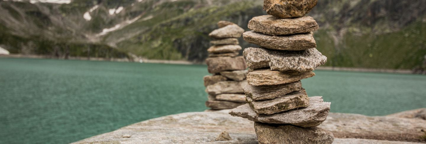 Stone tower with the mountain lake in background