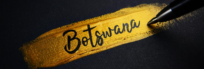 Botswana handwriting text on golden paint brush stroke