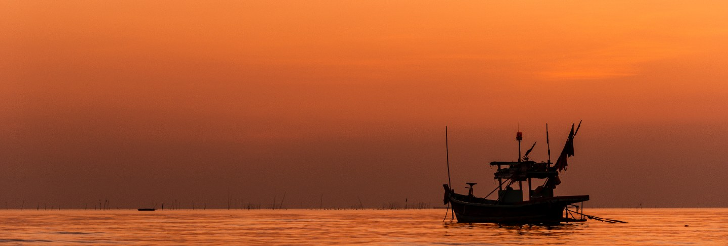 Silhouette of fishing boat with sunset in Trinidad And Tobago