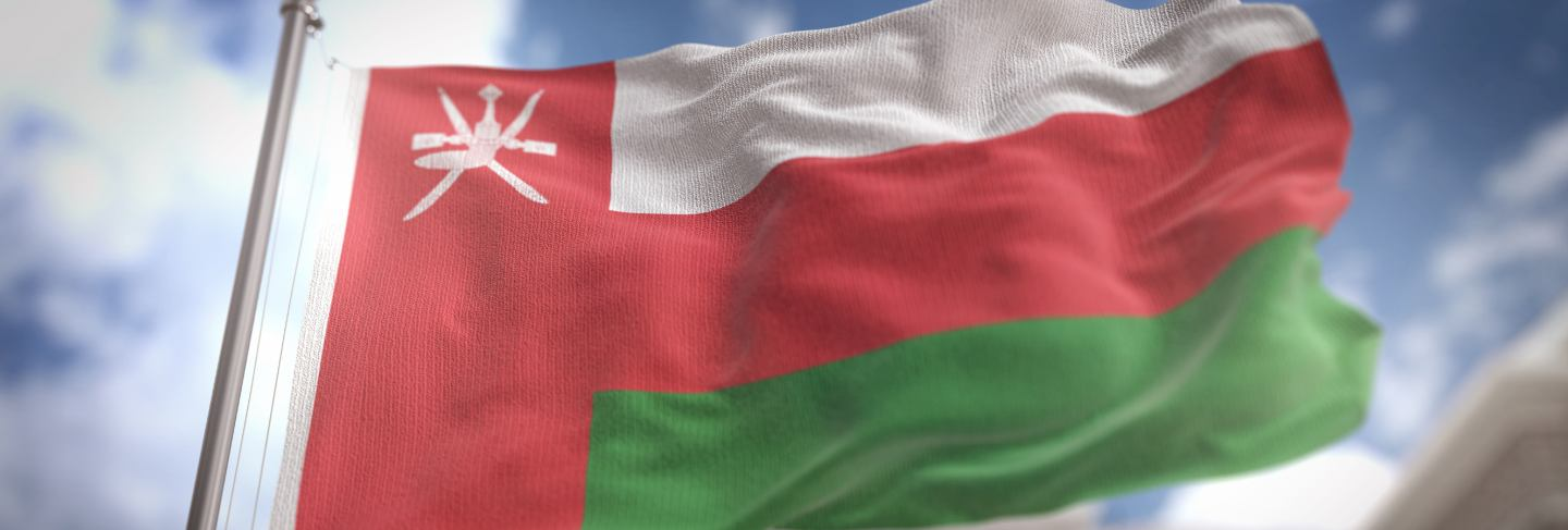 Oman flag 3d rendering on blue sky building background