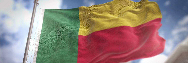 Benin flag 3d rendering on blue sky building