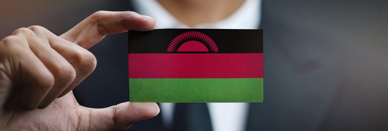 Businessman holding card of malawi flag