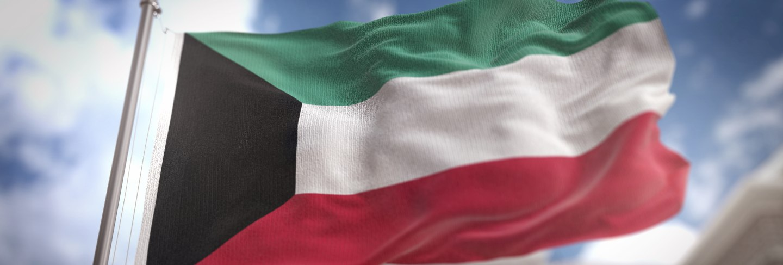 Kuwait flag 3d rendering on blue sky building background