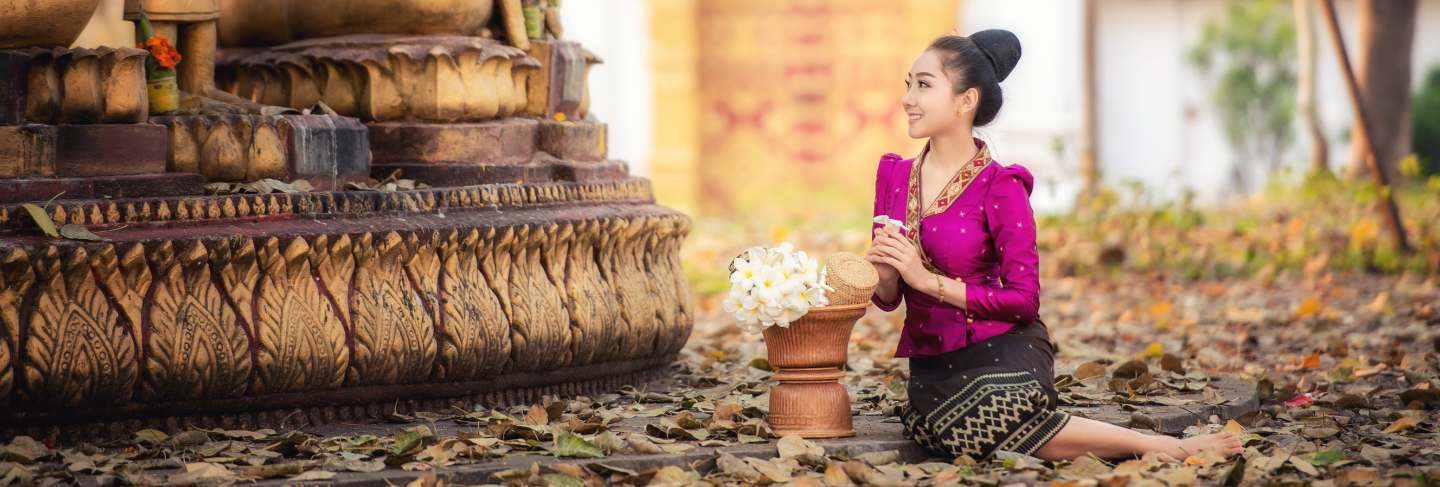 Beautiful laos girl in laos traditional costume, vintage style at vientiane, laos.