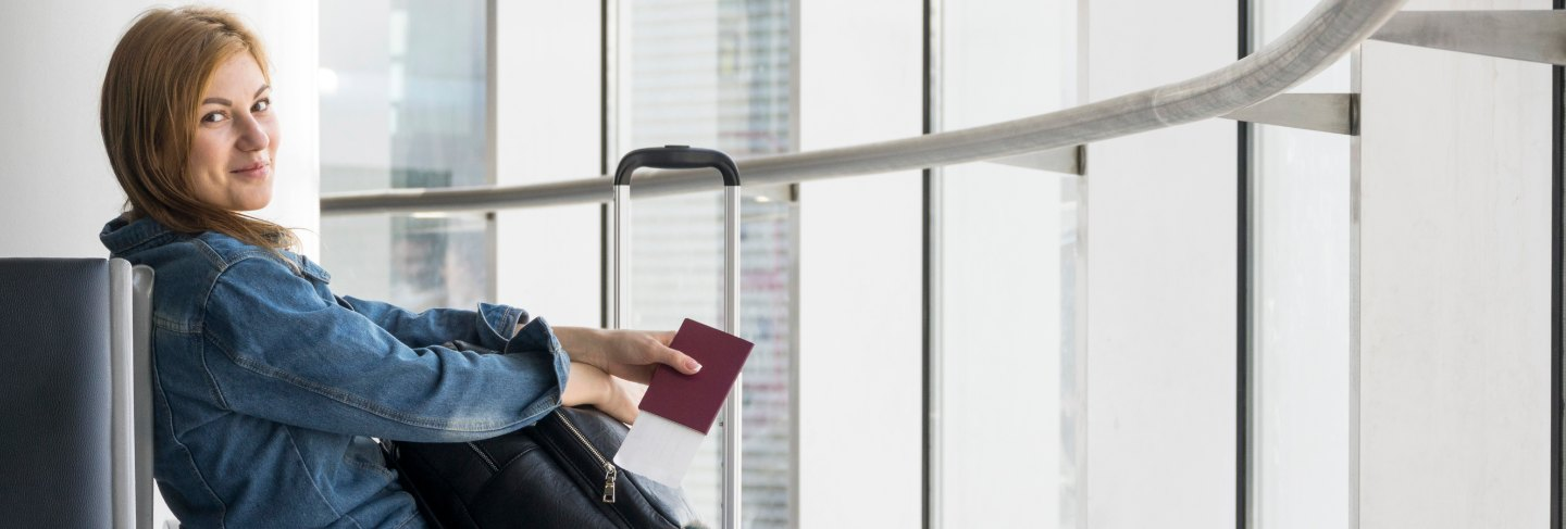 Side view of woman waiting for plane