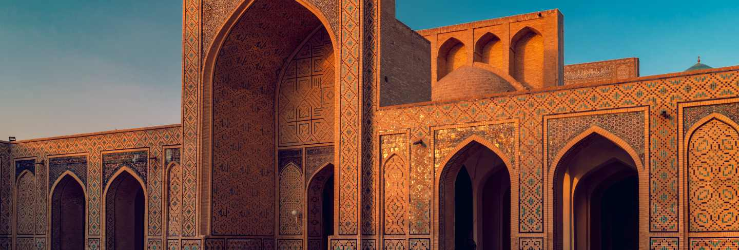 Courtyard of kalyan mosque at sunset, bukhara, uzbekistan. world heritage