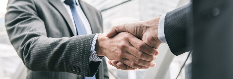 Businessman making handshake with partner