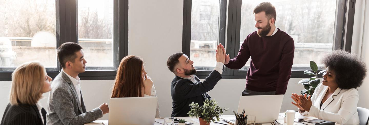 Low angle male coworkers meeting at office