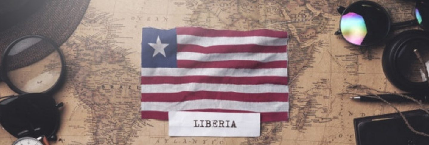 liberia-flag-traveler-s-accessories-old-vintage-map-overhead-shot_1379-3968