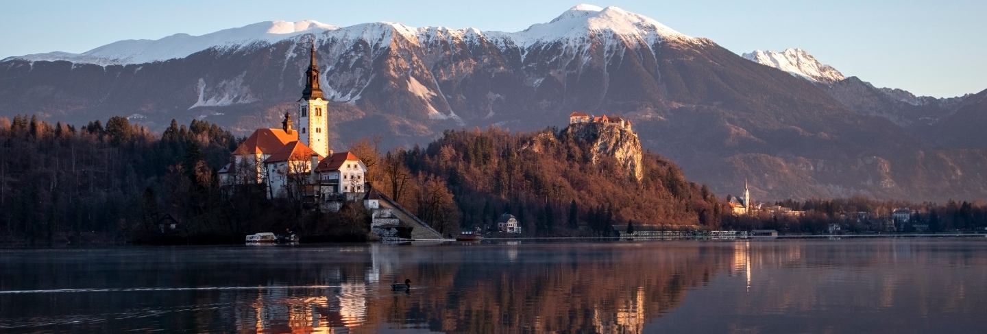 Bled lake a early winter morning in sunrise with the view of the island
