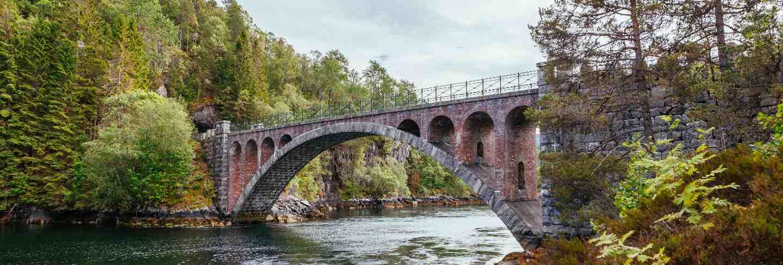 Old foot bridge over the river near alesund;