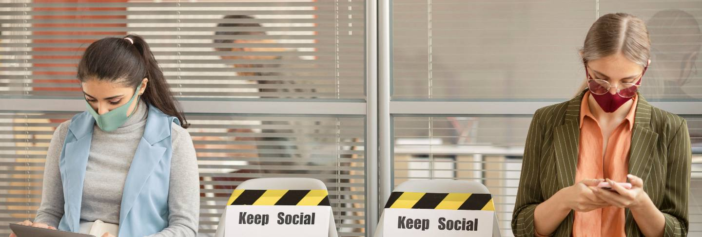 Employees respecting social distance at work