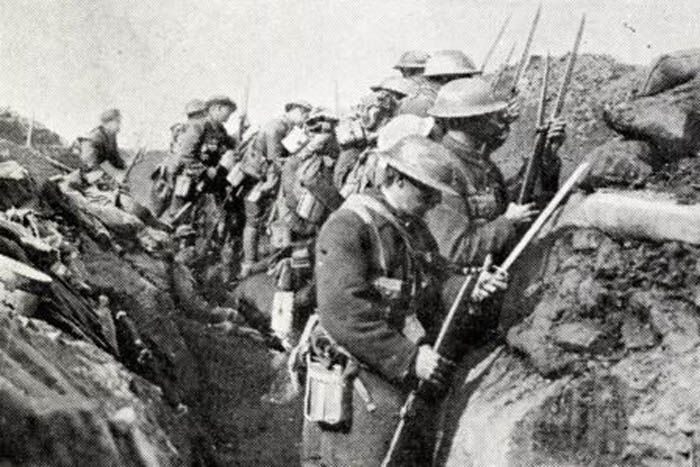 whistle for the advance has sounded as British infantry fix bayonets before leaving their trench on the Somme