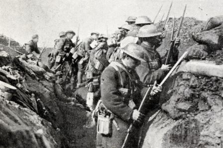 Whistle for the advance has sounded British infantry fix bayonets before leaving their trench on the Somme