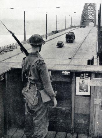 A soldier of General Dempsey's 2nd British Army guarding the bridge across the Rhine (Waal) at Nijmegen