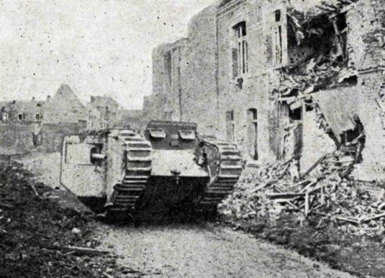 A tank moving down the ruins of a village on the Cambrai battle-front