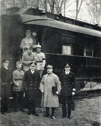 Admiral Sir Rosslyn Wemyss, General Weygand and Marshal Foch who is carrying the signed document in a satchel after the Armistice was signed at dawn on November 11th 1918