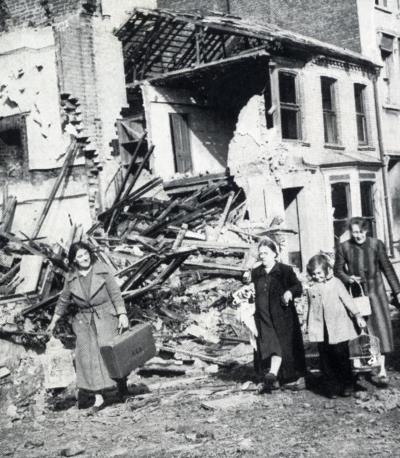 After a raid on West London women collect their few remaining possessions from their bombed homes