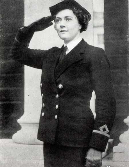 An officer of the Women's Royal Naval Service in uniform giving salute