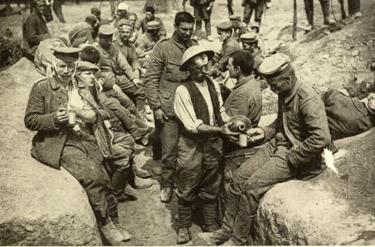German prisoners and British wounded being given water rations by the R.A.M.C