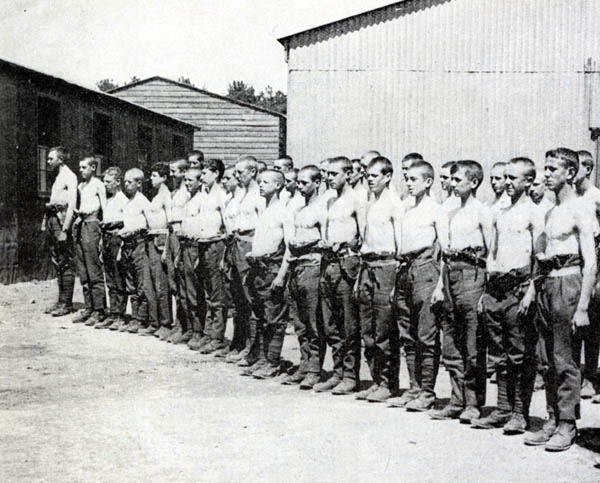 Boys of the 'under-age Battalion' are lined up for a medical inspection