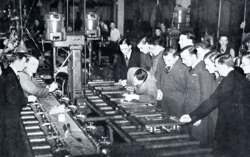Britain's fighter pilots are shown aircraft in construction during a visit to an aircraft factory