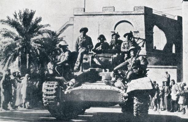 British Valentine tank parades through Tripoli on the 23rd January 1943