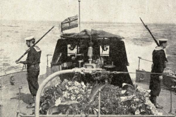 British sailors guarding the flower-covered coffin of Edith Cavell on HM Destoyer Rowena during the passage from Ostend to Dover