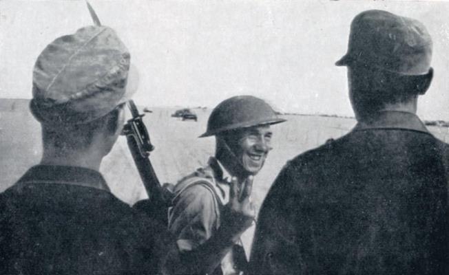 British soldier with German POWs